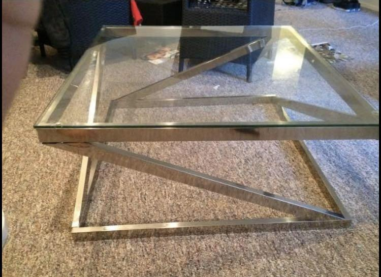 Metal and glass designer coffee table