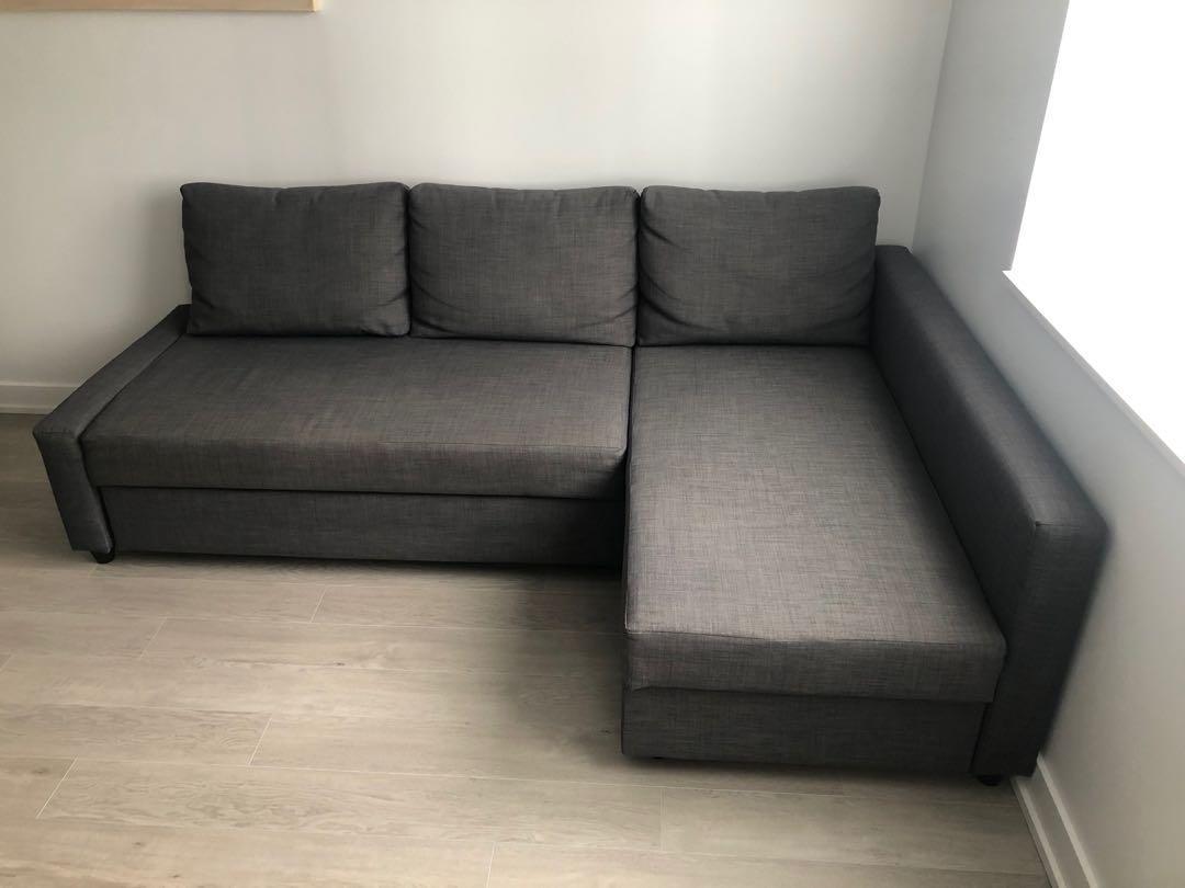 Corner sofa-bed with storage, dark gray