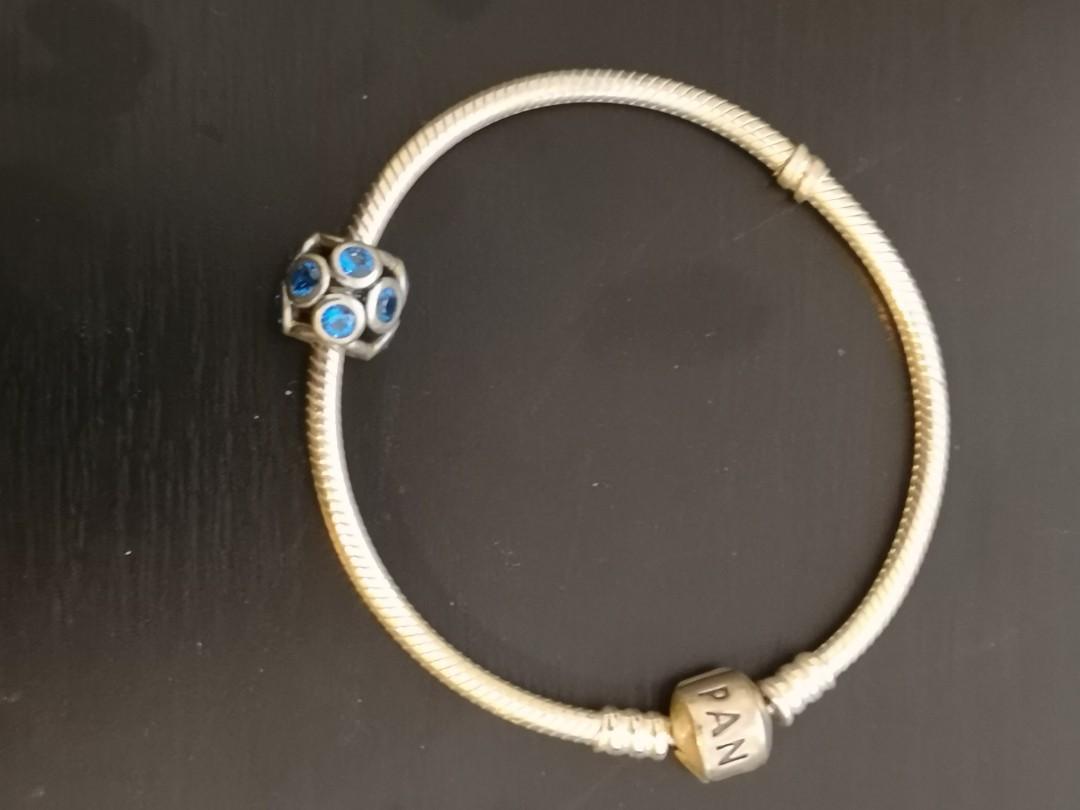 Pandora bracelet and blue charm