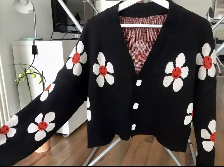 Black oversized cardigan with white smiley face flowers
