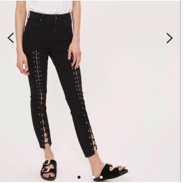 black laced up high rise skinny jeans