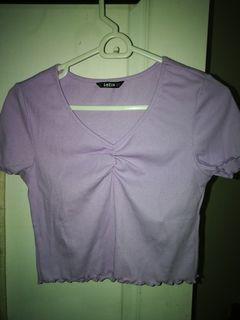 Light purple short sleeve top with lettuce trim