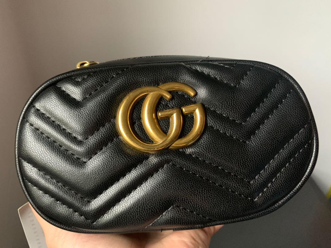 Black and gold mini Gucci belt bag with chain