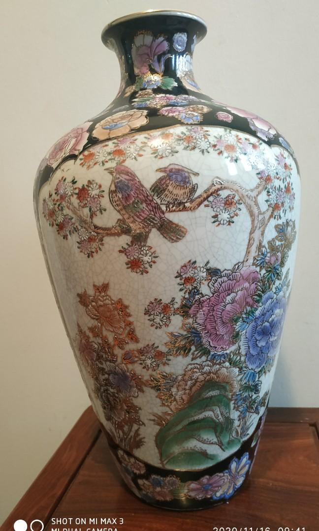14 inches oriental style flower vase.