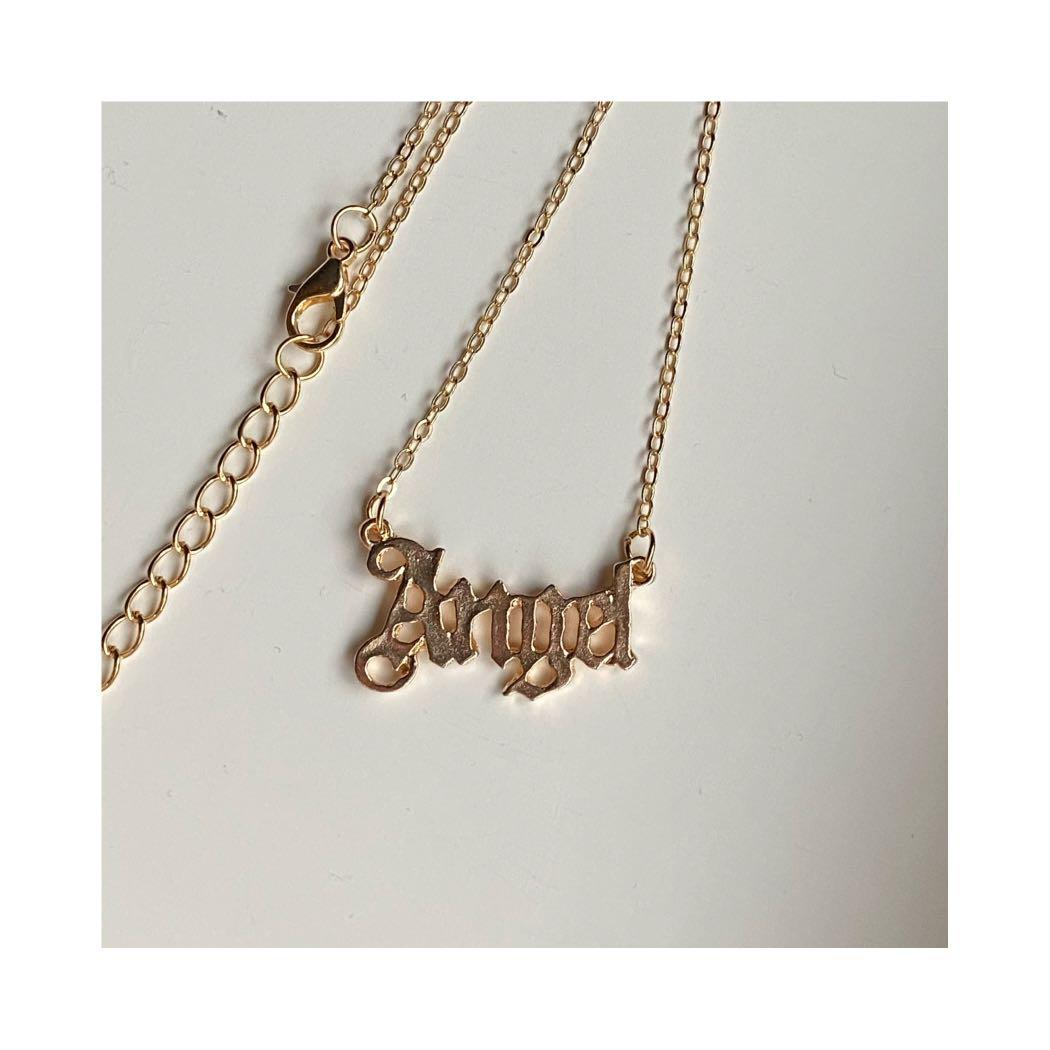 Angel font necklace in gold