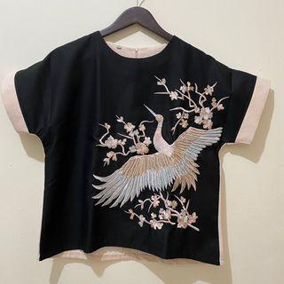 Atasan hitam burung