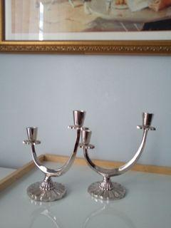 Two stainless steel two taper candle holders