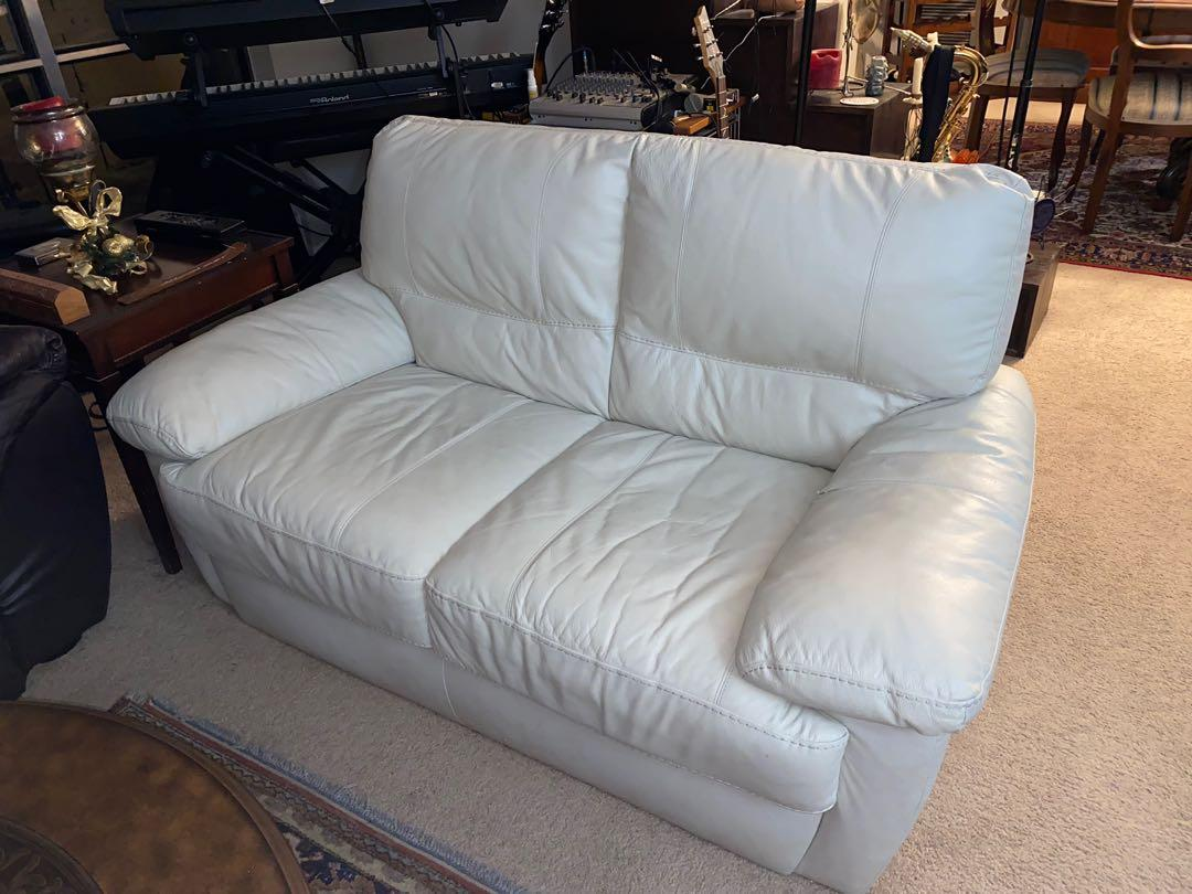 WHITE LEATHER LOVESEAT SOFA