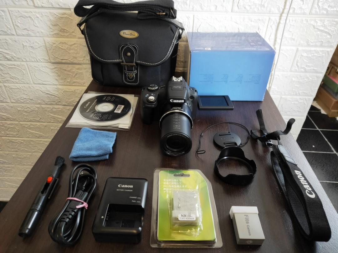 Canon SX50IS(200X ZOOM)+BATTERY+CHARGER+STRAP+HOOD+BAG+BOX+ALL can zoom very far until moon ,full moon can do it   English settings camera,