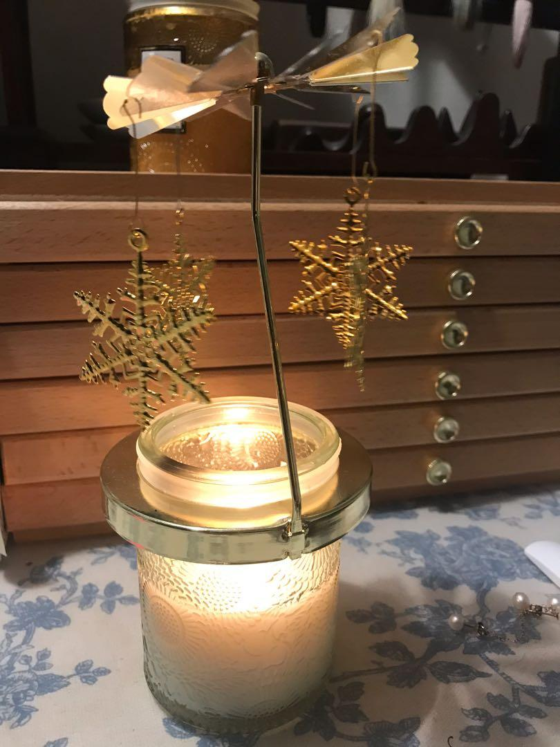 Snow flake candle spinner