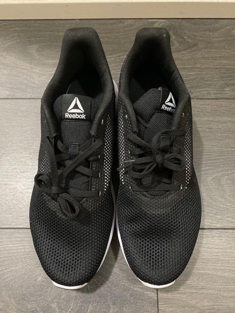 Brand new: Reebok black runners size 10
