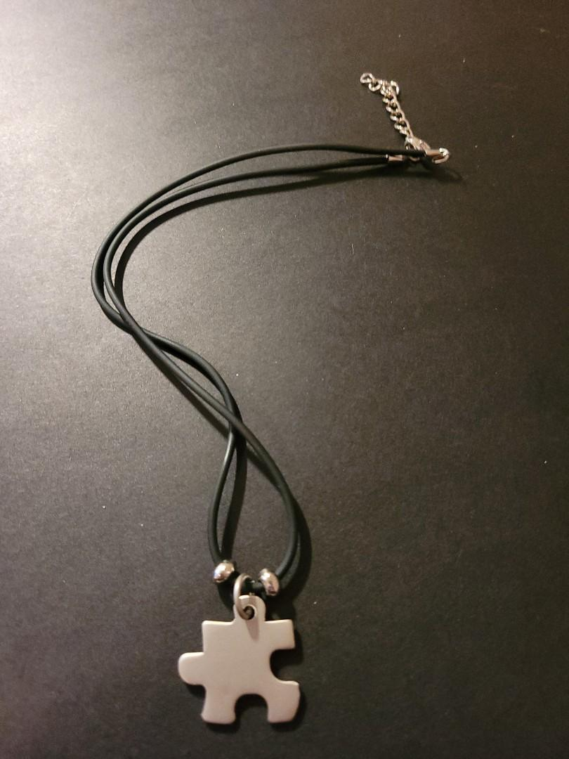 Puzzle shaped necklace