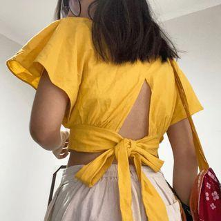 YELLOW BACKLESS TOP