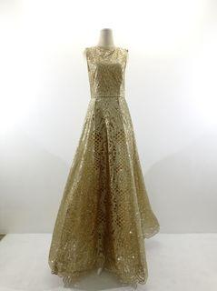 Gaun brokat kuning emas