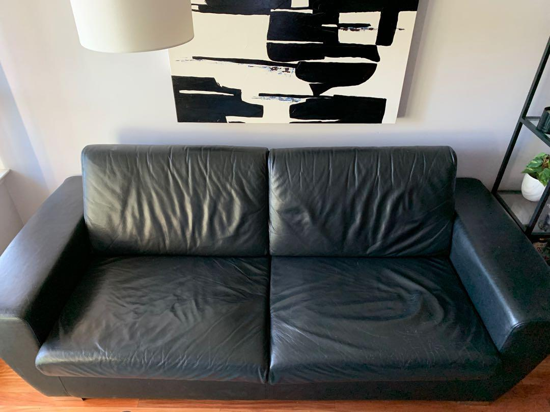 Black faux leather pull out couch
