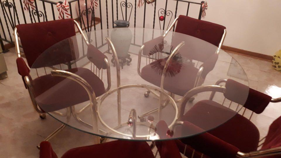 Glass round table with four chairs