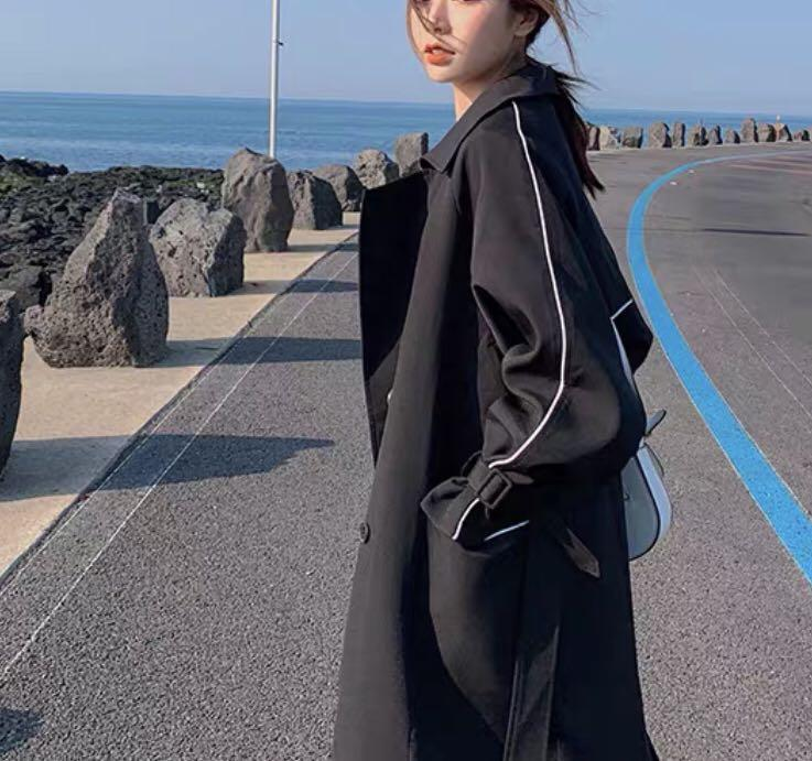 Black trench coat with white stripe