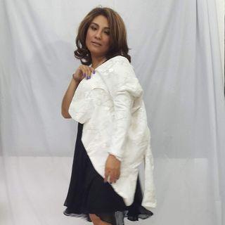 Embroidered jacket. Beige color.