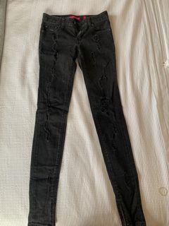 Levi's black ripped jeans