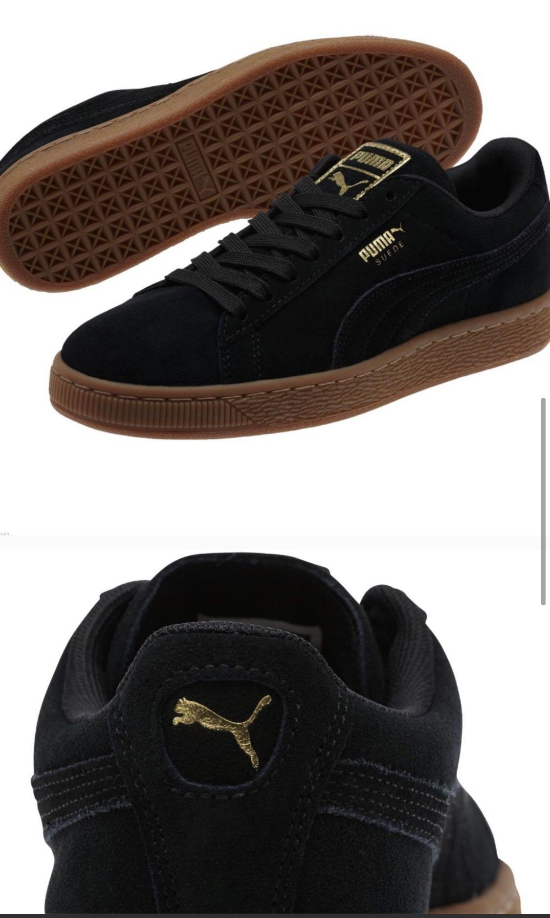 Puma suede black classic with a gold metallic line