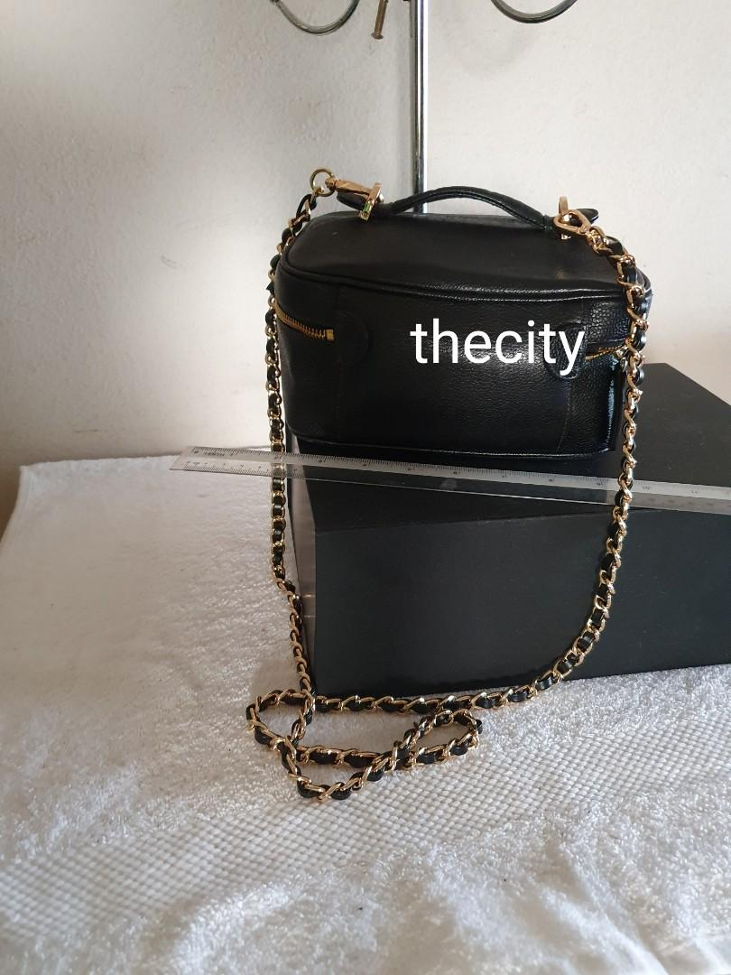 AUTHENTIC CHANEL VANITY BAG - BLACK CAVIAR LEATHER - EXTERIOR IS IN EXCELLENT CONDITION - INTERIOR NEWLY RE-LINED AT BAGSPA (COSTS $ 700+) - NEW ZIP PULL - COMES WITH EXTRA ADD LONG CHAIN STRAP FOR SLING / CROSSBODY