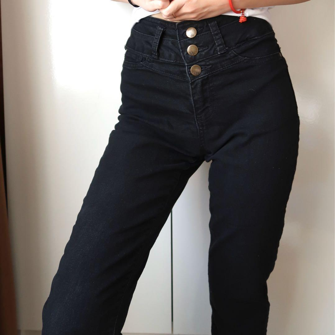 Size 6: multiple button black high waisted skinny jeans