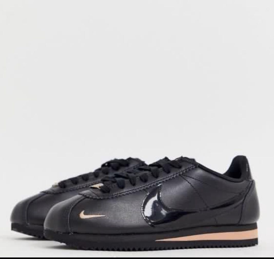 Nike cortez trainers in black and rose