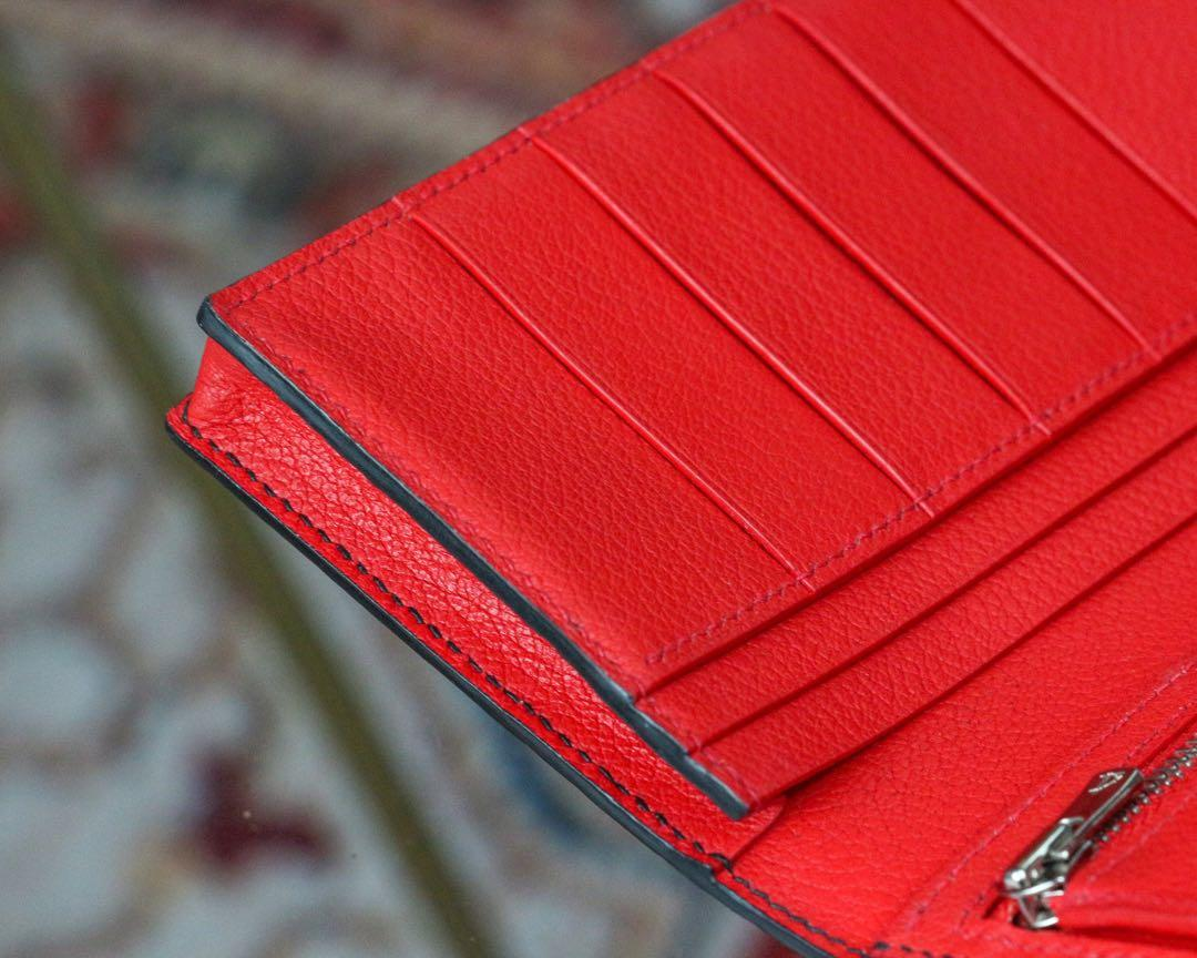 Handmade handstitched customized long wallet in Hermès alligator leather with Ferrari red Hermès chèvre leather on its interior. #MADEinSG