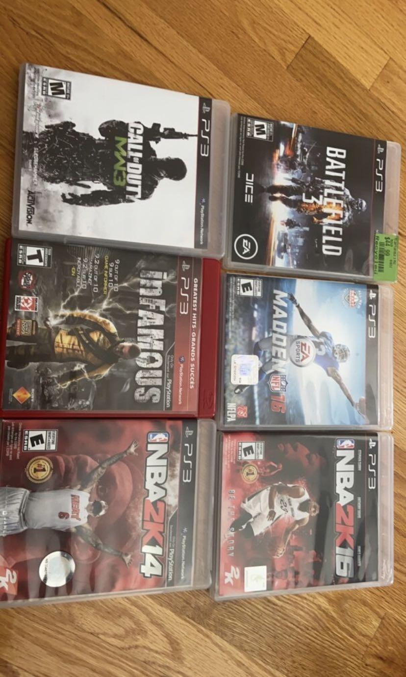 PS3 , Sony wireless gaming headset, 2 controllers, a bunch of games