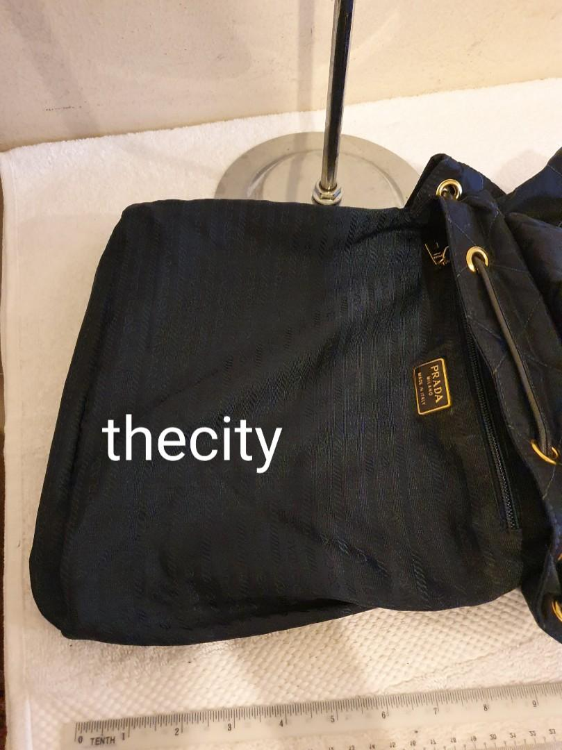 RARE DESIGN ! - AUTHENTIC PRADA BLACK NYLON CANVAS QUILTED BACKPACK - WITH TASSEL CHARMS - GOLD HARDWARE - CLEAN INTERIOR - (PRADA BACKPACKS NOW RETAIL AROUND RM 6000+)
