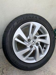 """Honda Jazz rim 15"""" including tyre Potenza re003"""