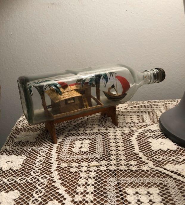 Hut in a glass bottle
