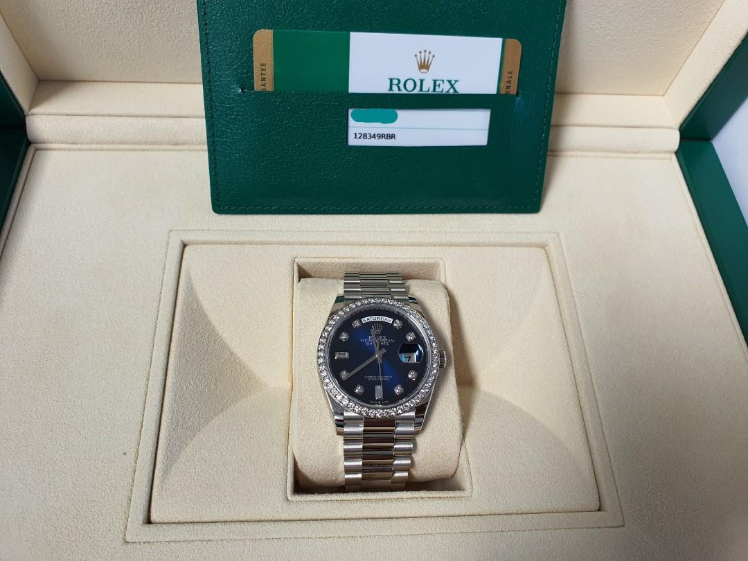 The oyster perpetual Rolex Day-Date 36 in 18 CT white gold, with blue Ombre, Diamond-set dial, Diamond-set bezel and a president bracelet