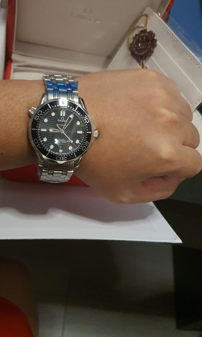 """Omeg. Seamaster 300M """"a powerful luminous coating with a ceramic rotatable rim that is even more striking."""