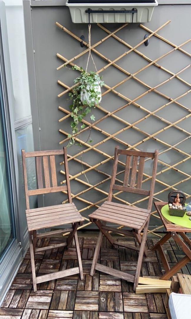 Two foldable wooden patio chairs