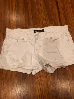 Levi's white ripped shorts