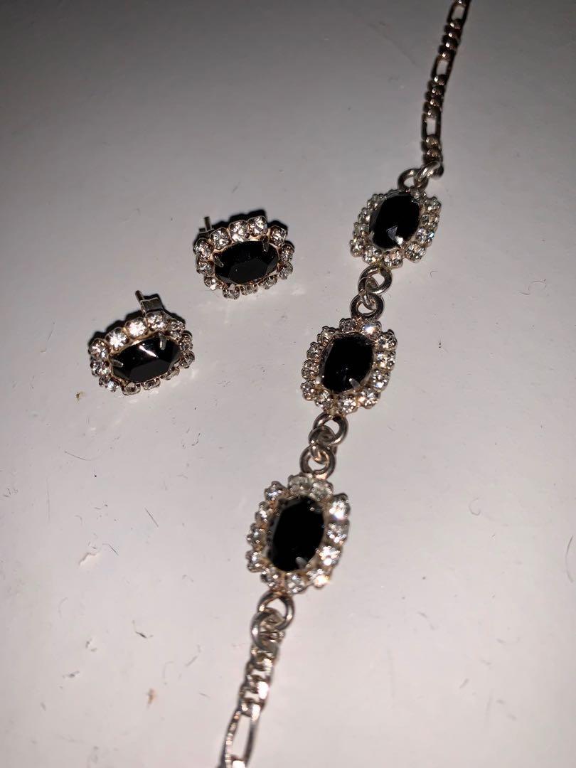 Brand new sterling silver bracelet & earrings set with black stones