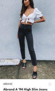A brand black denim jeans, size 12, worn once