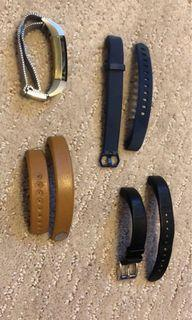 Gold Fitbit Alta with 4 extra straps and 3 charging cables