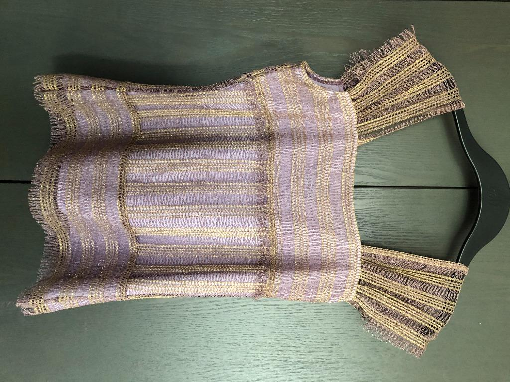 purple top with golden stitching