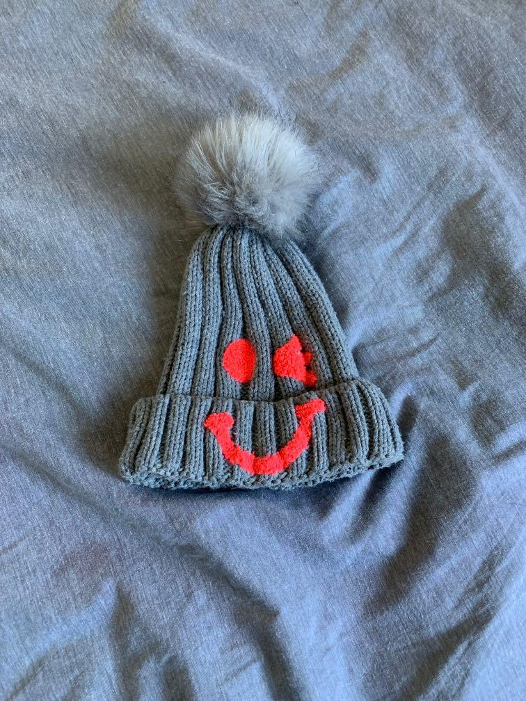 Winky smiley face beanie