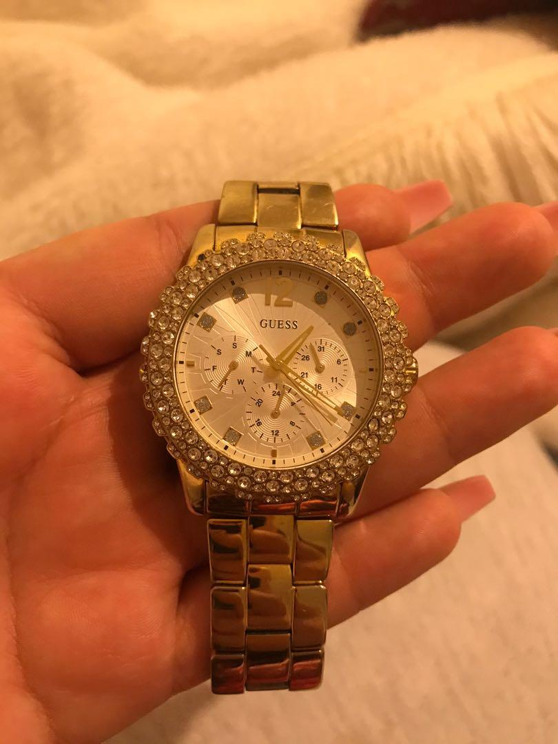 GUESS (GOLD PLATED )WATCH .