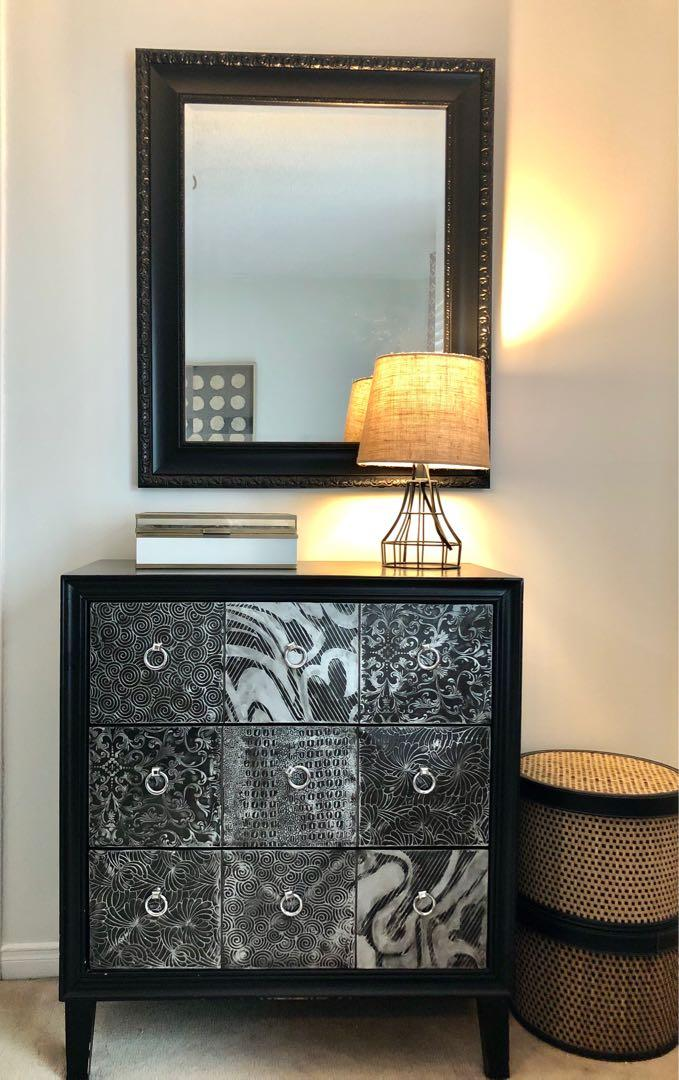 Black dresser with mirror and lamp