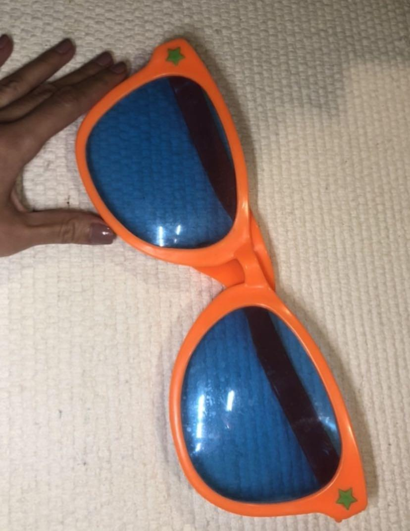 BAYVIEW/EGLINTON PICKUP. Large sunglasses costume
