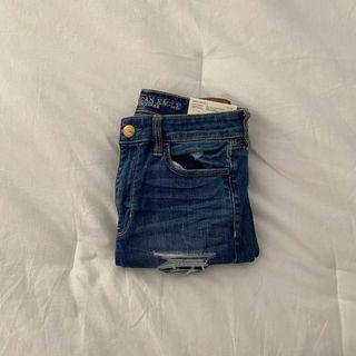 american eagle slasher blue jeans