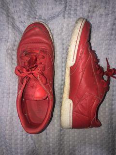Red Reebok sneakers