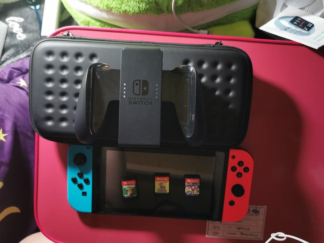 Nintendo switch with case and 3 games