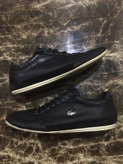 Lacoste black leather sneaker with black platted steel logo