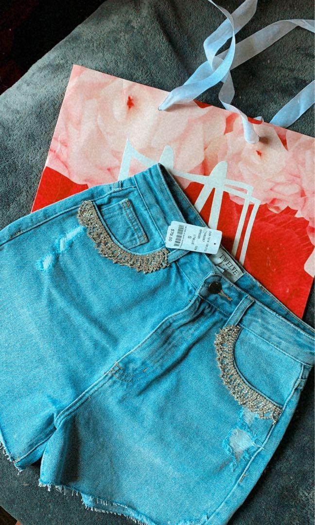 Denim shorts with Rhinestone pockets Size S.