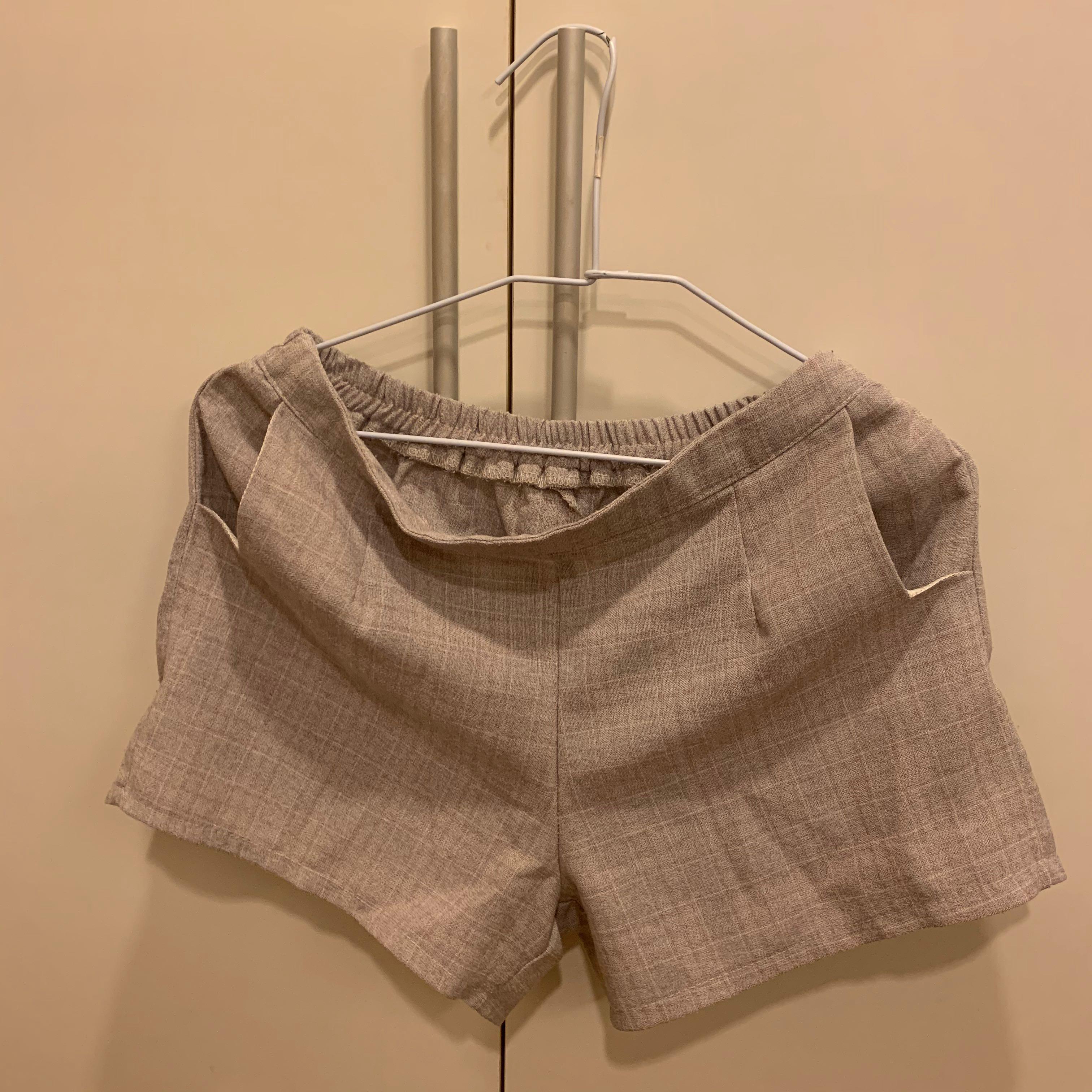 可正式也可休閒 CP值高的藕粉色細格紋短褲